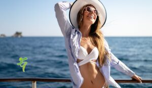 Beach vacation. Beautiful woman in sunhat and bikini enjoying summer trip